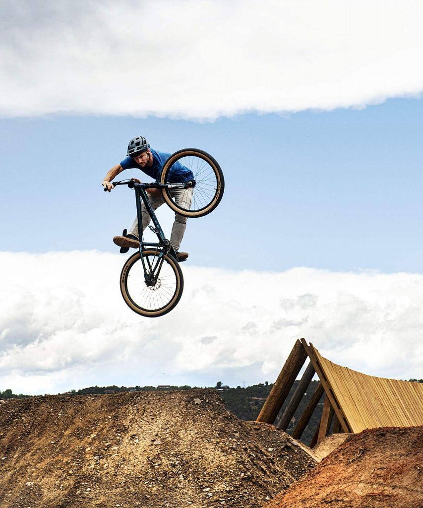 Erik Obermeyer hits a jump in the new bike park at Crown Mountain Park on Thursday, June 25, 2020. Obermeyer expressed that he was excited that the Roaring Fork Valley finally had a bike park.