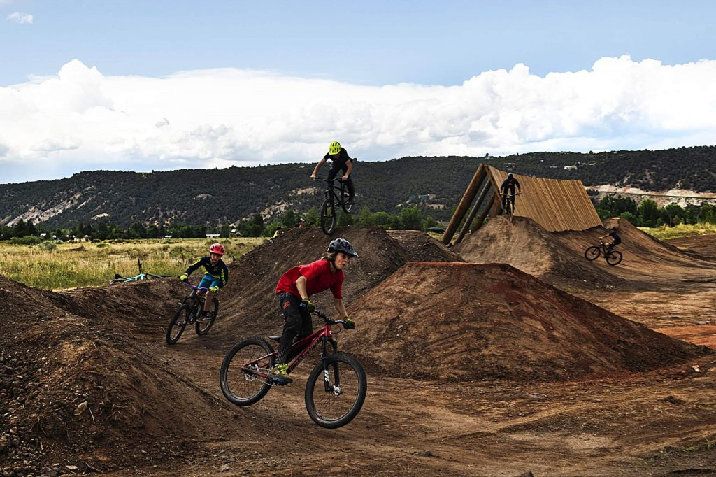 Young bikers try out the new bike park at Crown Mountain Park on Thursday, June 25, 2020.