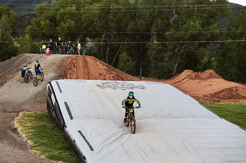 Ames Dallabetta, 10, rides down the airbag set up at the entrance of the new bike park in Crown Mountain Park on Thursday, June 25, 2020.