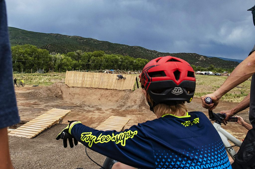 Bikers wait their turn to hit the new bike park in Crown Mountain Park on Thursday, June 25, 2020.