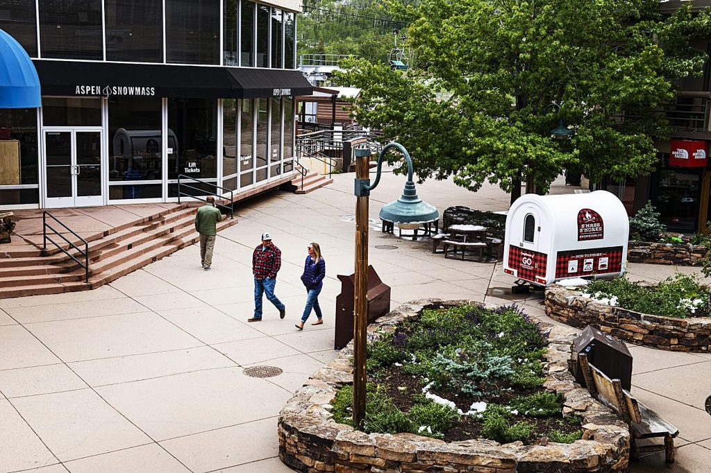 People walk through Snowmass Village Mall on Tuesday, June 9, 2020. (Kelsey Brunner/The Aspen Times)
