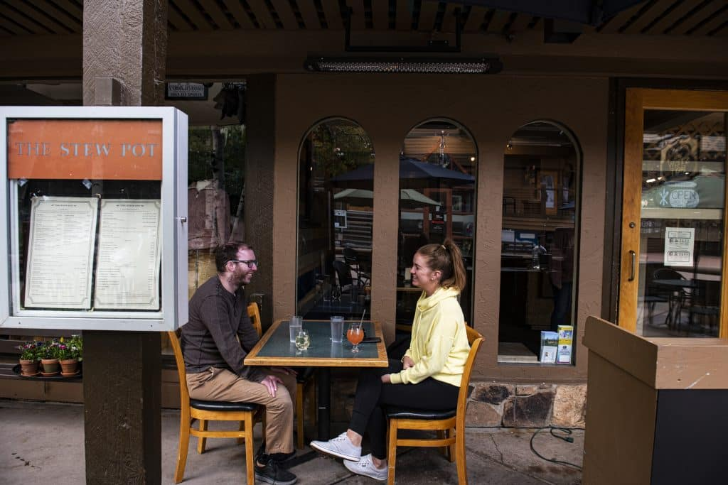 Snowmass roommates Sam Kliewe, left, and Melissa Ferraris share an afternoon meal at The Stew Pot in Snowmass Village Mall on Tuesday, June 9, 2020.