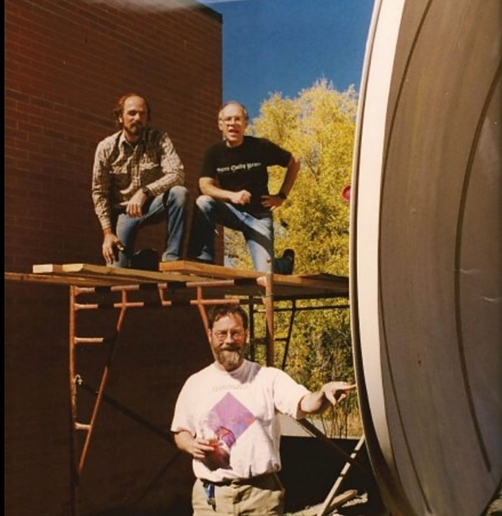 Sy Coleman, top right, stands by the satellite dish behind Aspen Public Radio's studio at the Red Brick Center for the Arts. Coleman started KAJX out of his living room. Michael Stranahan is pictured at the bottom.