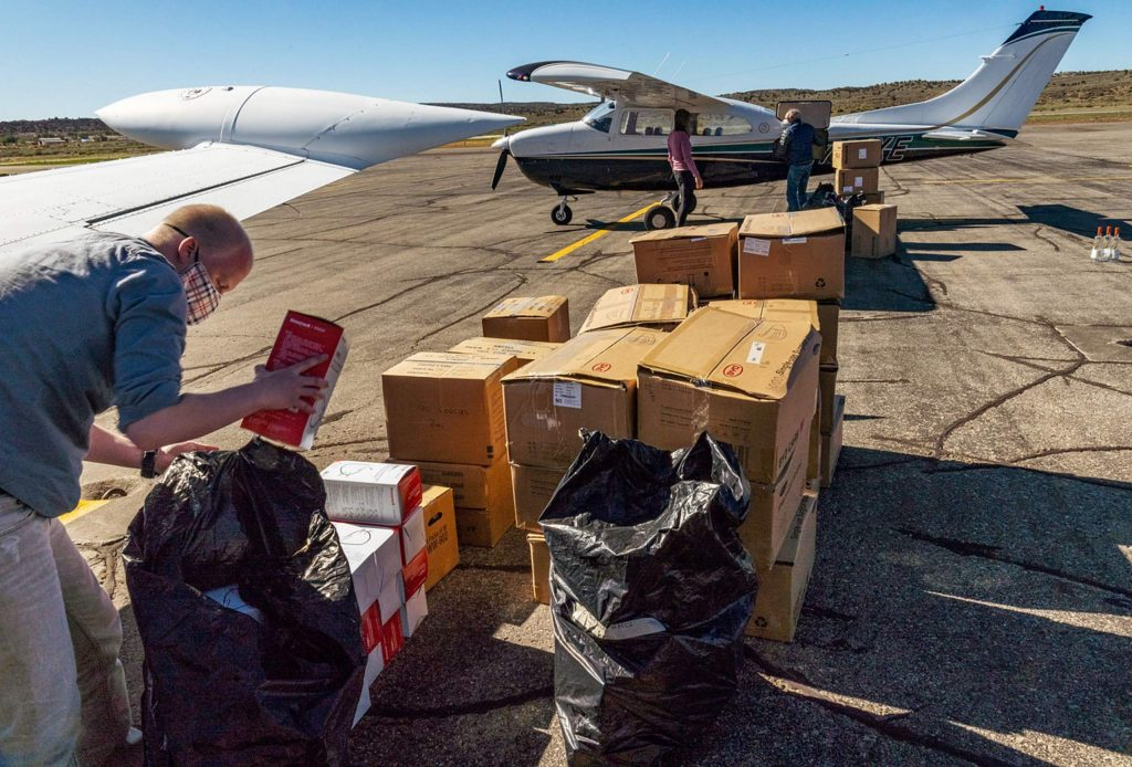 Bryan Larsen of Aspen unloads KN95 masks from Walter Chi's airplane Wednesday, June 10, in Gallup, New Mexico.