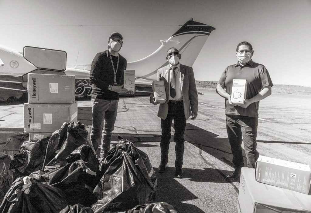 From left, Deon Ben, Mavajo Tohatchi Land Use Chair, Parnell Halona, Navajo legislator, and Lt. Governor Carleton Bowekaty from Pueblo of Zuni, dsplay the PPE delivered from Aspen to Gallup on Wednesday.