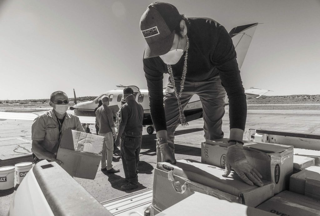Deon Ben, EcoFlight board member and Navajo Tohatchi Land Use Chair, on right, loads PPE delivered from Aspen for distribution in the Navajo Nation.