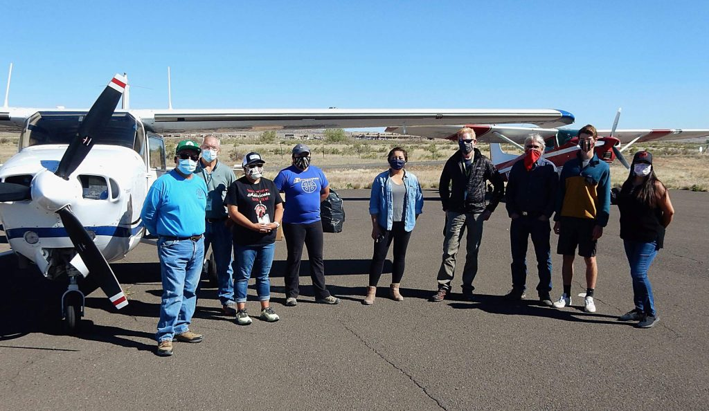 A group of Hopi tribe representatives and pilots from Aspen pose Wednesday after personal protective equipment was delivered from Aspen to the Hopi Reservation.
