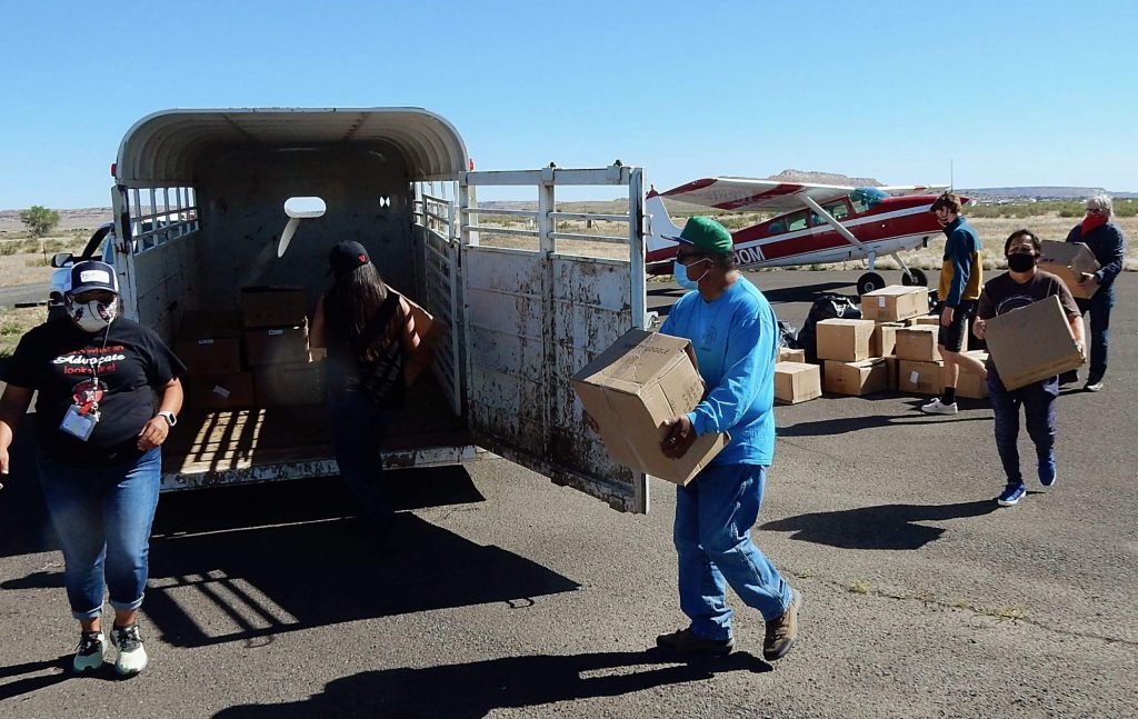 Clark Tenakhongva, vice chair of the Hopi Tribe, center, loads equipment onto a horse trailer after it was delivered from Aspen. He and members of the Hopi Foundation were distributing the equipment to the 12 villages of the reservation.