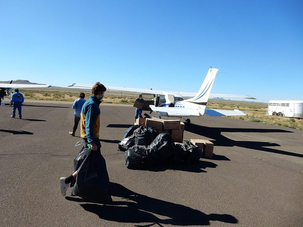 Lander Greenway unloads personal protective equipment from three airplanes that was delivered to the Hopi Reservation in Arizona. Lander hitched a ride with his dad, Hawk Greenway.