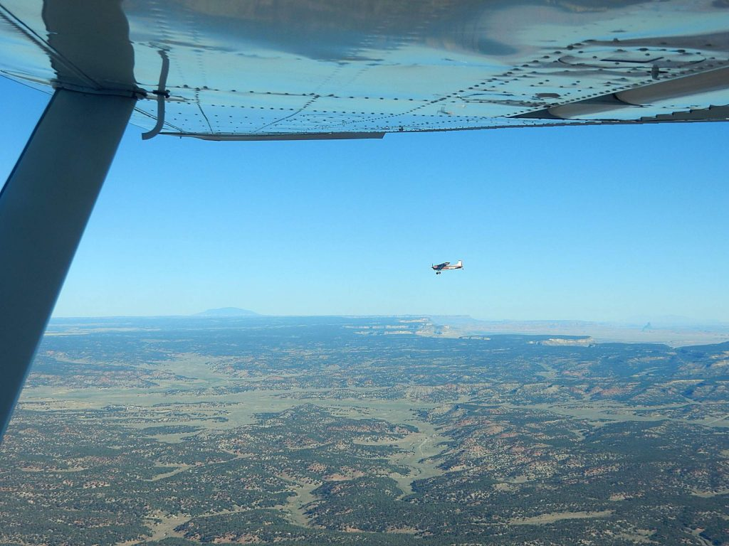 Hawk Greenway's Cessna 185 crosses over canyonlands en route to the Hopi Reservation in Arizona from Aspen on Wednesday. His plane was one of three delivering equipment to battle the coronavirus.
