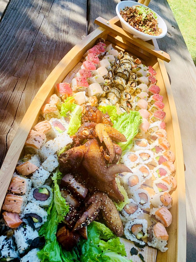 A THC & Sushi boat with specialty rolls.