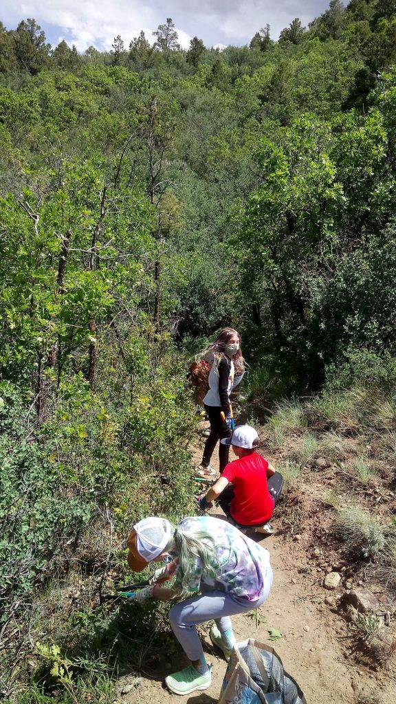 Kids in the Ramberg family help with work on the rerouted Light Hill Trail.