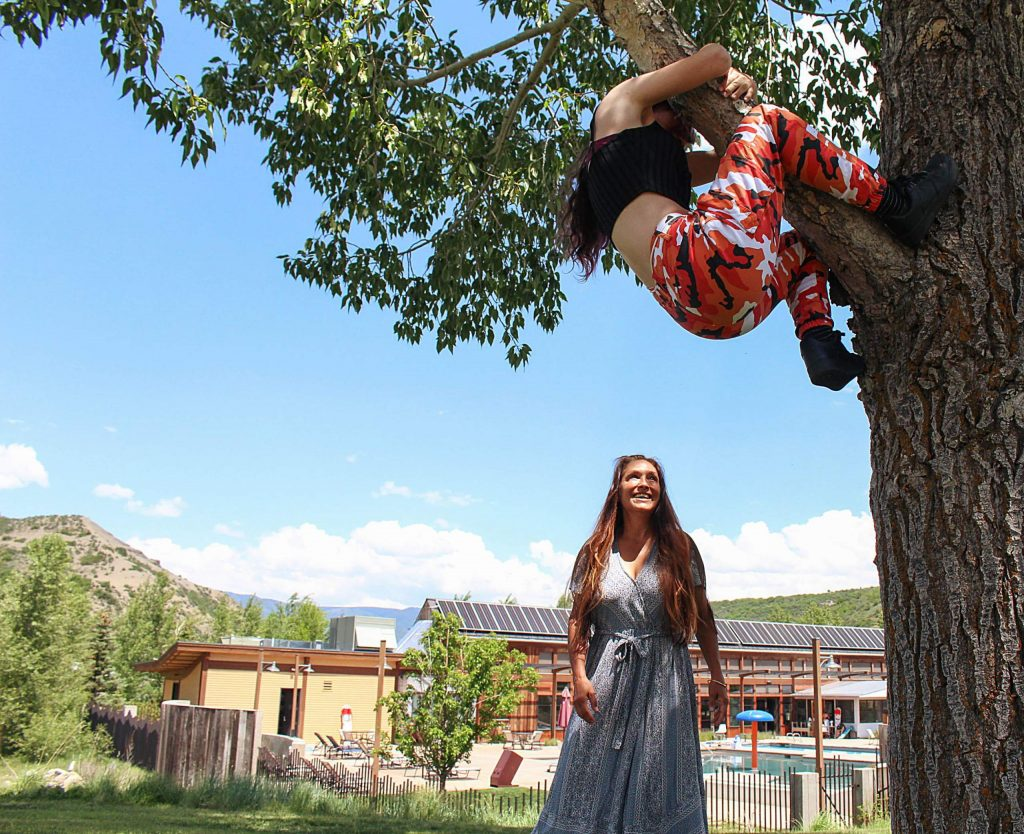 Michelle McCuiston smiles up at her daughter Jasmine as she climbs a tree in Snowmass Town Park on June 18, 2020. (Maddie Vincent/Snowmass Sun).