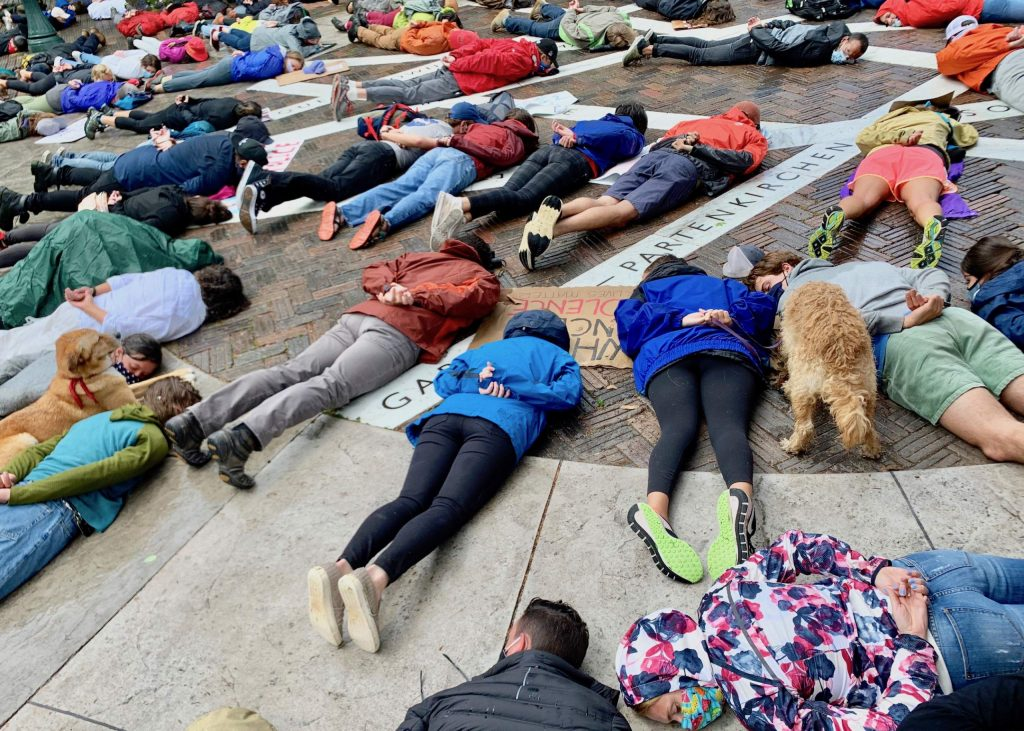People lie face down on the ground near Wagner Park following a Black Lives Matter protest on Saturday, June 6, 2020, in Aspen. It was a symbolic nod to George Floyd, who was recently killed by a Minnesota police officer. His death sparked the current protests sweeping the country. (Photo by Austin Colbert/The Aspen Times)