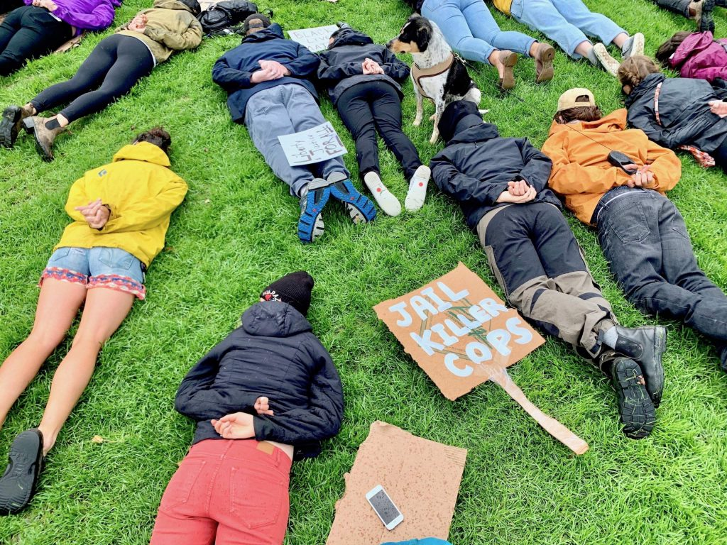 People lie face down on the ground at Wagner Park following a Black Lives Matter protest on Saturday, June 6, 2020, in Aspen. It was a symbolic nod to George Floyd, who was recently killed by a Minnesota police officer. His death sparked the current protests sweeping the country. (Photo by Austin Colbert/The Aspen Times)