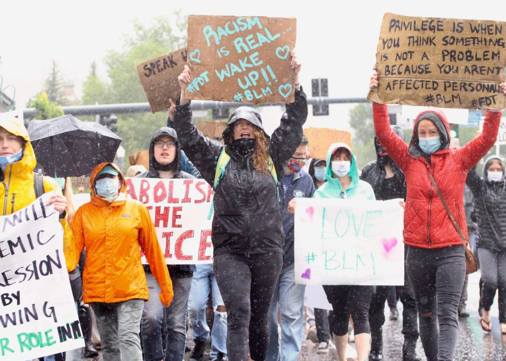 An estimated 300-400 people took to the rainy streets for a Black Lives Matter protest on Saturday, June 6, 2020, in Aspen. (Photo by Austin Colbert/The Aspen Times)
