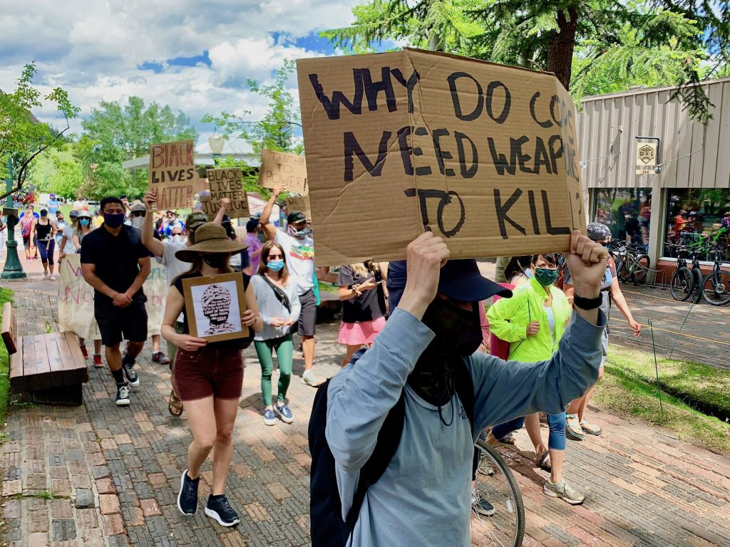Protesters make their way through the downtown core during a Black Lives Matter march on Saturday, June 13, 2020, in Aspen.