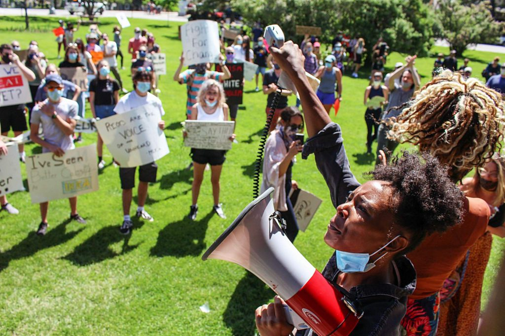 Jenelle Figgins, co-founder of Roaring Fork Show Up, leads a chant at Paepcke Park in Aspen on Sunday, June 14, 2020.