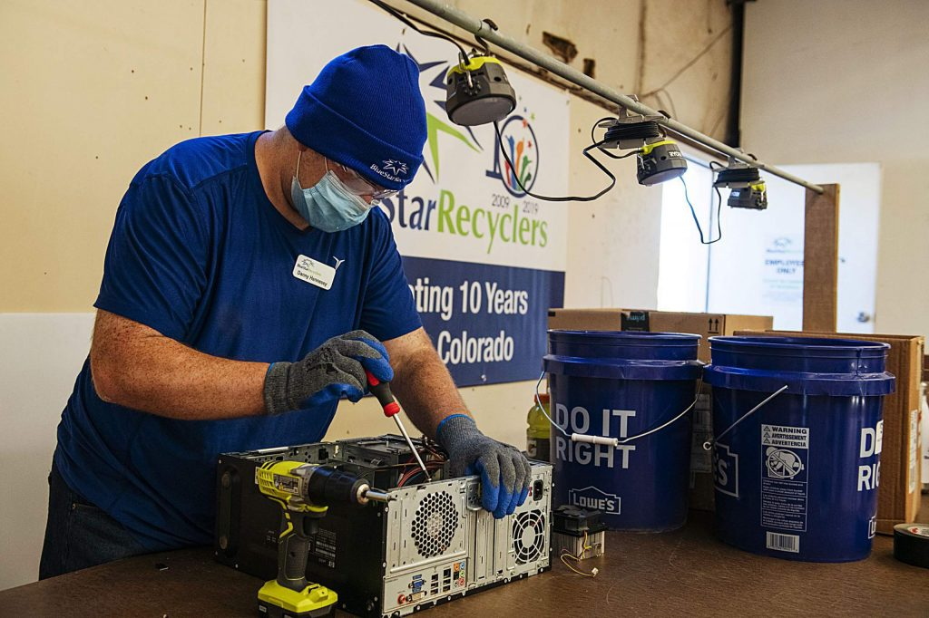 Blue Star Recyclers' Danny Hennessy takes apart a desktop computer at the new Basalt location on Wednesday, June 24, 2020. (Kelsey Brunner/The Aspen Times)