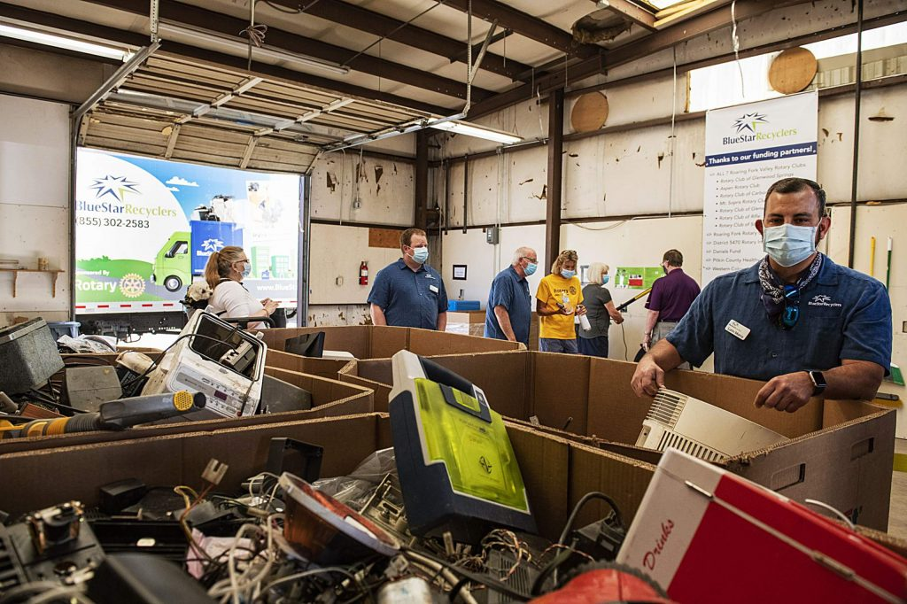 Blue Star Recyclers' Lorin Marco, right, explains the different boxes of discarded electronics as people explore the new Basalt location during the grand opening of the mountain recycling operations in the Roaring Fork Valley on Wednesday, June 24, 2020. (Kelsey Brunner/The Aspen Times)
