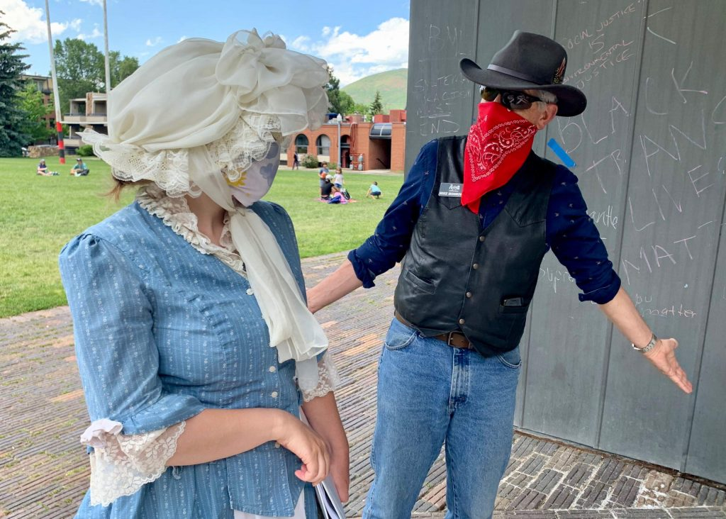 History coach Mike Monroney, right, jokes with intern Katia Galambos during one of the Aspen Historical Society's guided tours on Thursday, June 18, 2020, in downtown Aspen. (Photo by Austin Colbert/The Aspen Times)
