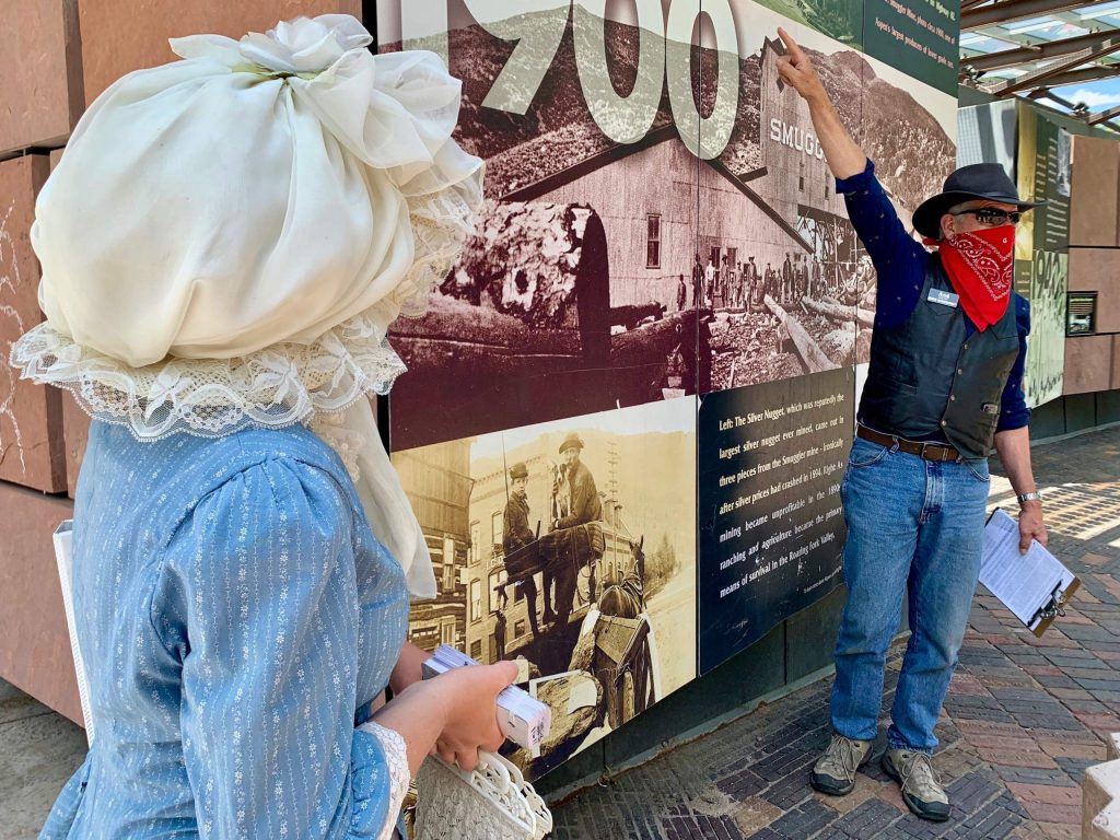 History coach Mike Monroney, right, talks while intern Katia Galambos watches to the side during one of the Aspen Historical Society's guided tours on Thursday, June 18, 2020, in downtown Aspen. (Photo by Austin Colbert/The Aspen Times)