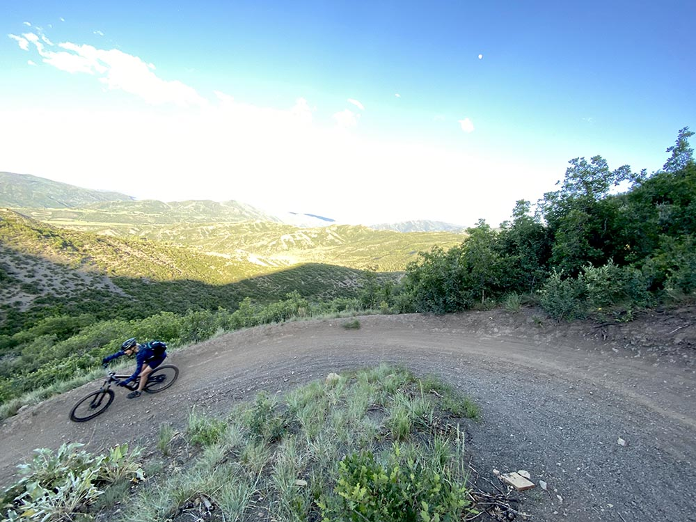 Mountain biker Colleen Irvin rounds a corner on Seven Star trail in Snowmass.