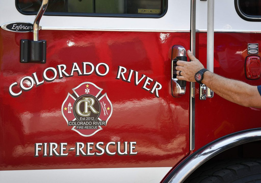 CRFR Engineer Jonathan Baker jumps in one of the fire engines at Station 43 after a routine vehicle check Tuesday in Rifle. Colorado River Fire Rescue announced they will be reducing services and combining staff as they make budget cut through the end of the year.
