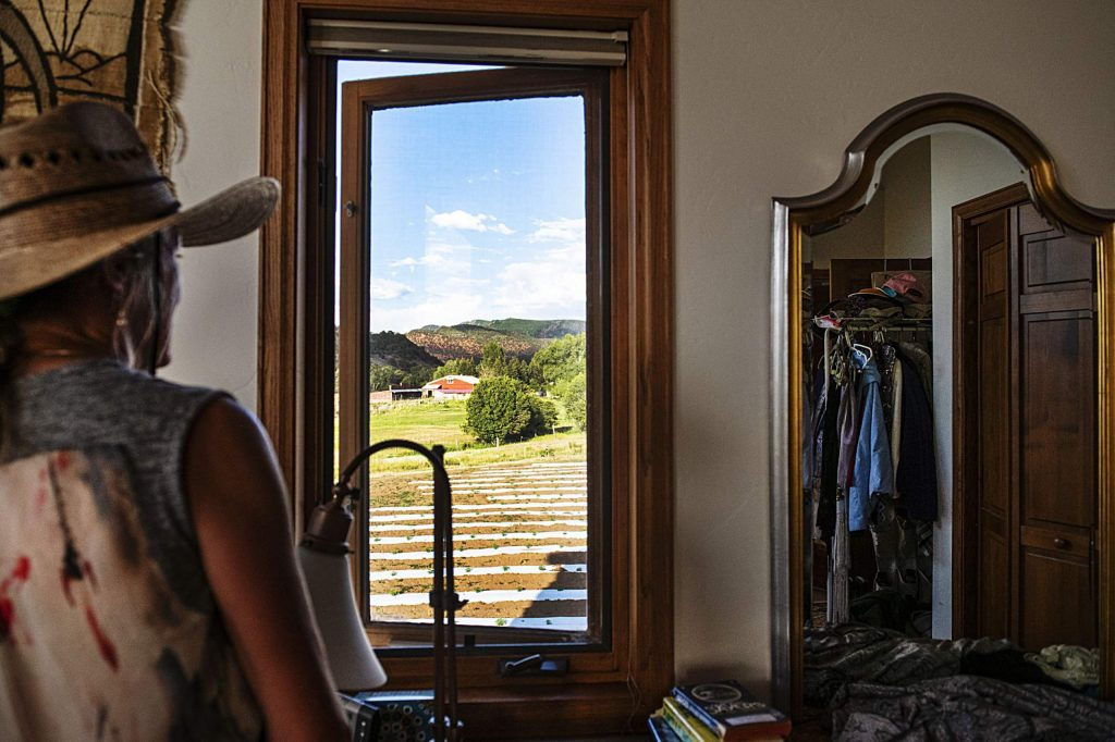Cathy Markle looks out at the neighboring hemp farm from her bedroom window on Monday, July 6, 2020.