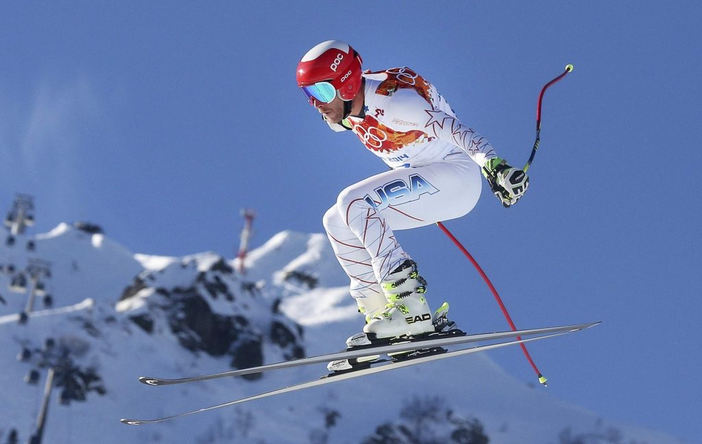 United States' Bode Miller makes a jump during men's downhill combined training at the Sochi 2014 Winter Olympics, in Krasnaya Polyana, Russia. Bode Miller is launching a winter sports academy to help produce the next wave of standouts on the snow. Miller's partnering with the Institute for Civic Leadership Academy to open an online learning program geared toward students in grades 7-12.