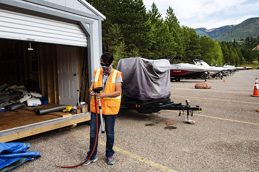 Jaime McCullah explains about the use of certain tools to decontaminate boats if standing water is found during an inspection at Ruedi Reservoir on Wednesday, July 22, 2020. (Kelsey Brunner/The Aspen Times)