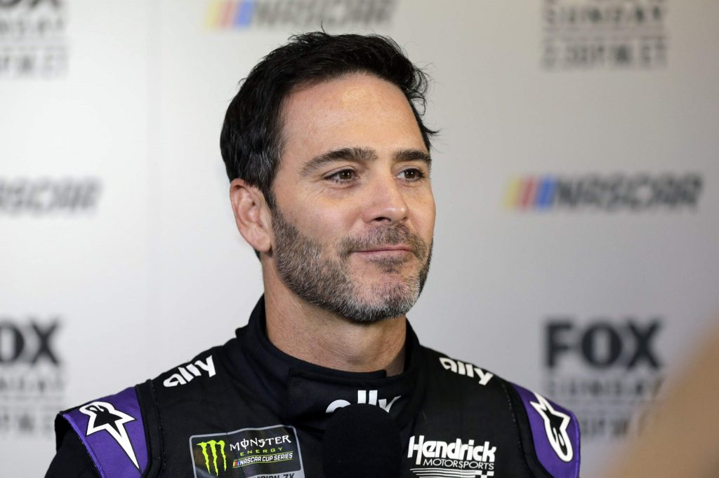 In this Feb. 13, 2019, file photo, driver Jimmie Johnson smiles during media day for the NASCAR Daytona 500 auto race at Daytona International Speedway in Daytona Beach, Fla. Seven-time NASCAR champion Jimmie Johnson has twice tested negative for the coronavirus and has been cleared to race Sunday, July 12, 2020 at Kentucky Speedway. Johnson missed the first race of his Cup career when he tested positive last Friday.