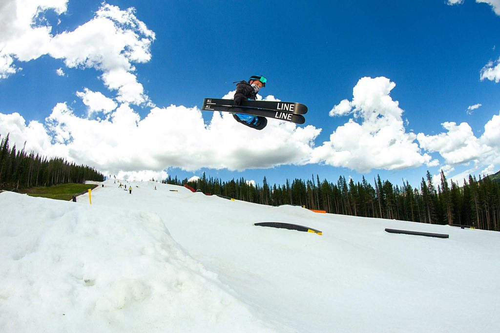 A young skier hits a hip at the summertime Woodward Copper Central Park terrain park at Copper Mountain Resort