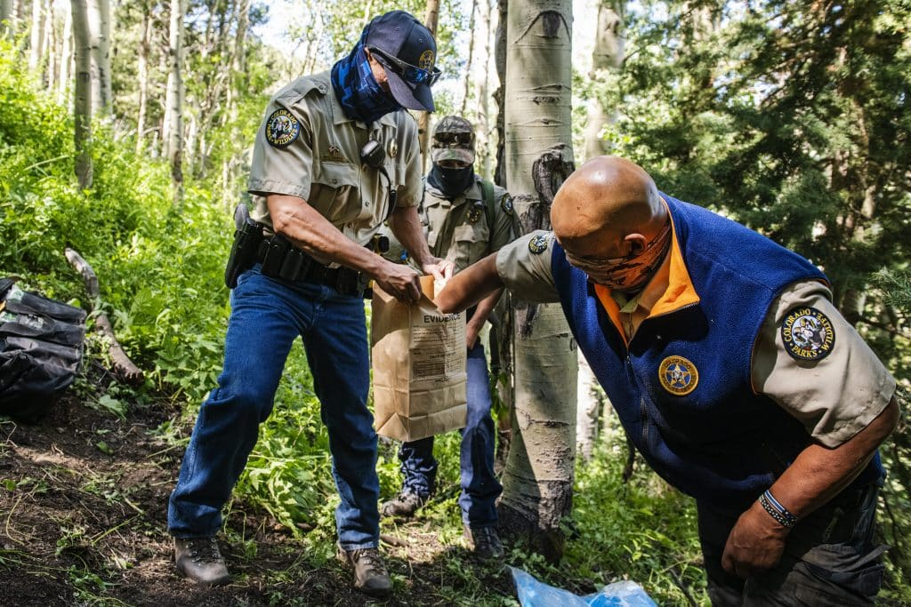 Colorado Parks and Wildlife officers collect evidence from a bear that was euthanized in an abandoned mine on Aspen Mountain, Friday, July 10, 2020. The euthanized bear was suspected of attacking an Aspen man early on Friday morning.