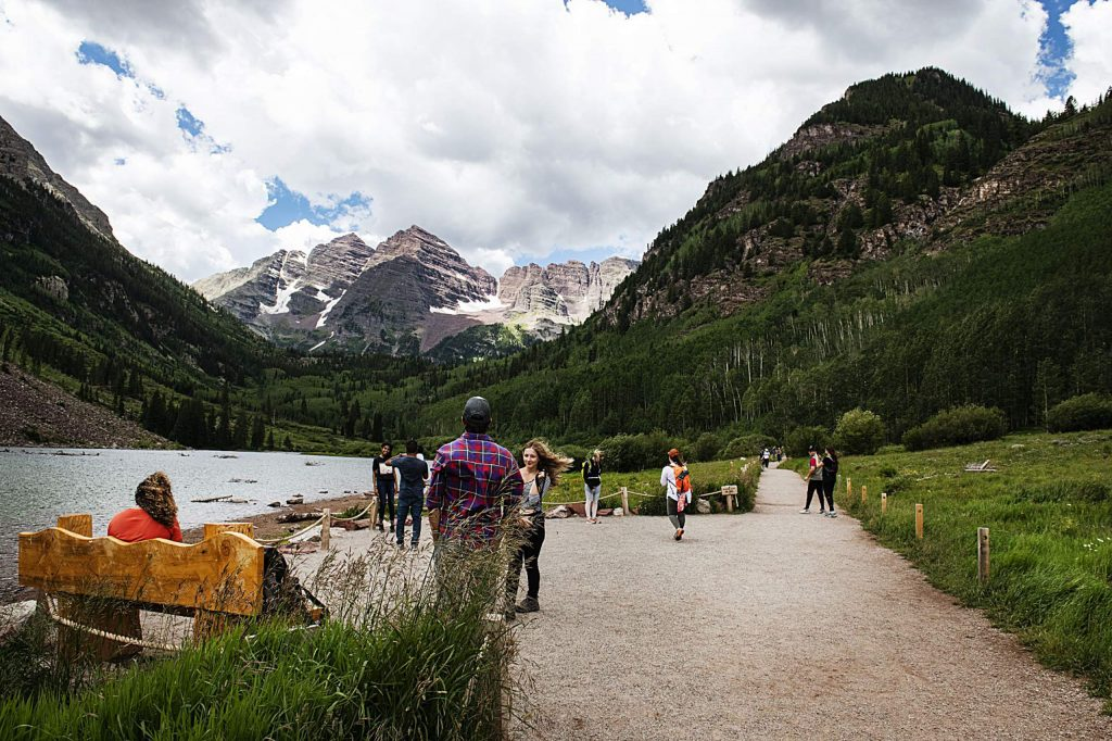 People take photos in view of the Maroon Bells on Wednesday, July 29, 2020. (Kelsey Brunner/The Aspen Times)