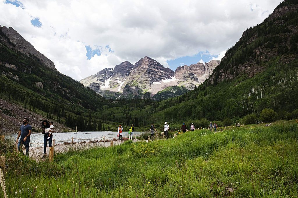 People utilize the paths around Maroon Lake while visiting the scenic area on Wednesday, July 29, 2020. (Kelsey Brunner/The Aspen Times)