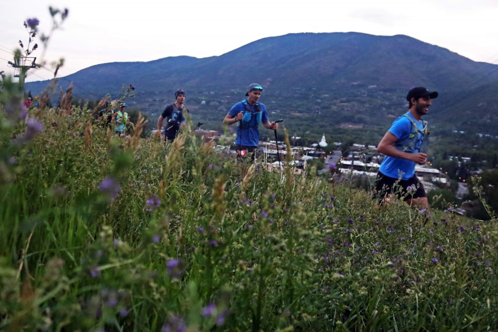 Runners head up Aspen Mountain at the start of the Audi Power of Four trail run on Sunday, July 29, 2018. (Photo by Austin Colbert/The Aspen Times).