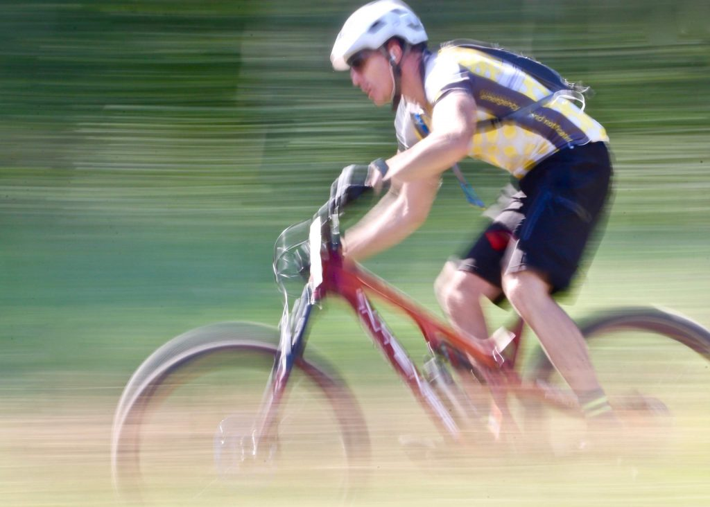 A rider competes in the Audi Power of Four mountain bike race on Saturday, Aug. 17, 2019 in Snowmass. (Photo by Austin Colbert/The Aspen Times)