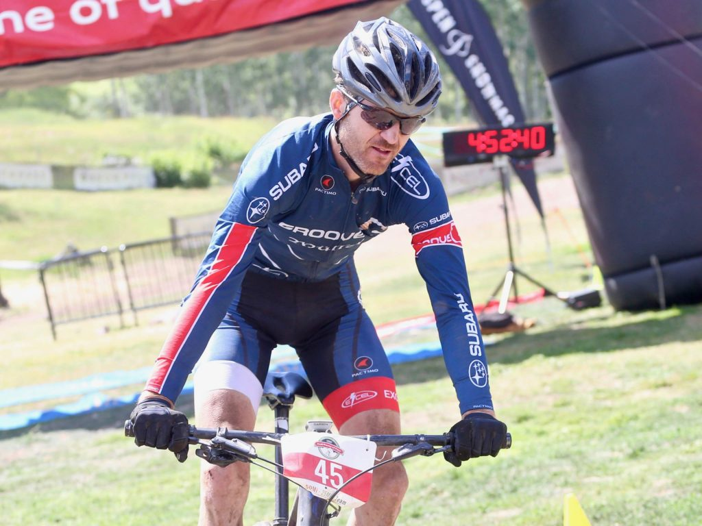 Lakewood's Thomas Herman crosses the finish line after winning the Audi Power of Four mountain bike race on Saturday, Aug. 17, 2019 in Snowmass. (Photo by Austin Colbert/The Aspen Times)