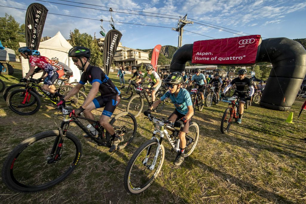 Racers take off from the start of the Audi Power of Four mountain bike race on Aug. 17, 2019, in Snowmass Village.