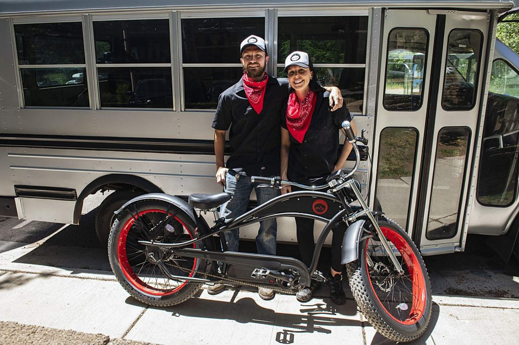 Derek and Ryan Attema stand in front of their bus workshop for their new e-bike business, Silver City Cycles, outside of their Hunter Creek Apartment in Aspen on Wednesday, July 1, 2020. (Kelsey Brunner/The Aspen Times)