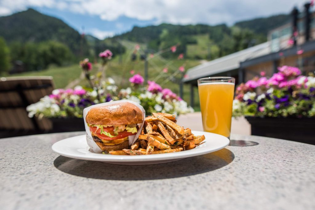 Ajax Tavern, located at the base of Aspen Mountain, offers movie nights, live music on the weekends and a new take-out dining option.