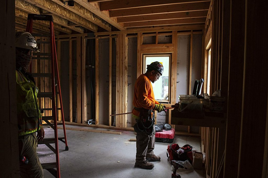 A crew works on homes at the Coffey Place housing project in Snowmass on Thursday, July 16, 2020. (Kelsey Brunner/Snowmass Sun)