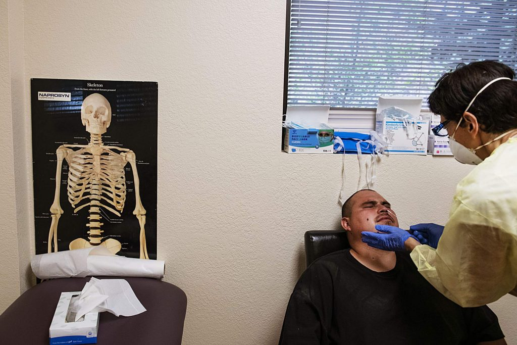 Edgar Ruiz reacts to the COVID-19 test as nurse Lisa O'Neil administers it in a sectioned off wing of MidValley Family Practice in Basalt on Thursday, July 2, 2020.