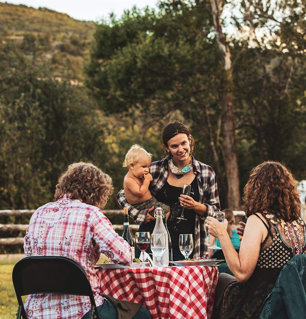 Erin Cuseo with son Wekta talk with diners during Dinner on the Farm