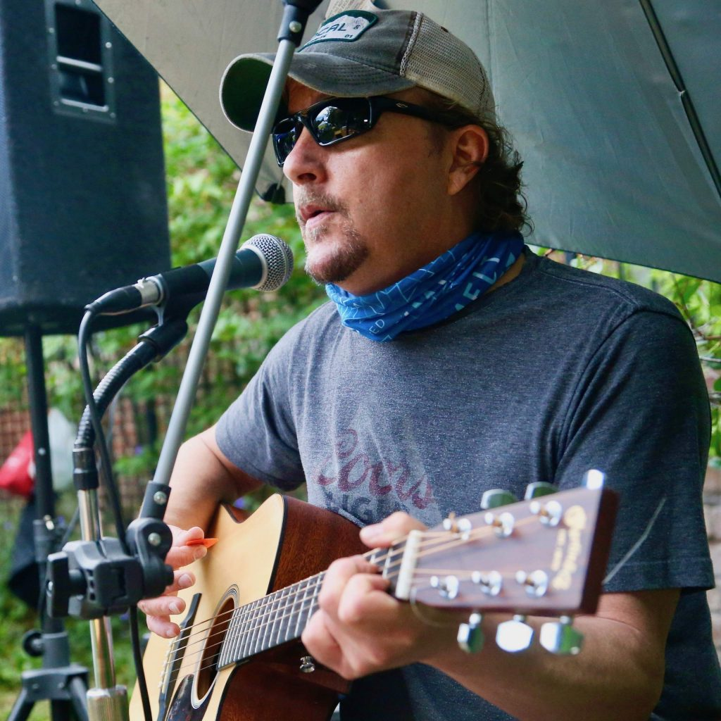 Local musician Tom Ressel plays during the farmer's market on Saturday, July 4, 2020, in downtown Aspen. (Photo by Austin Colbert/The Aspen Times)
