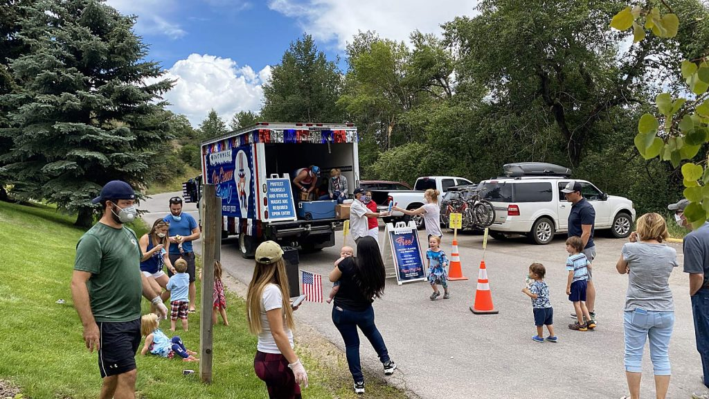 Families line up Saturday for the Snowmass Ice Cream Anti-Social event that rolled through the village to celebrate the Fourth of July. The makeshift ice cream truck made a number of stops through the village before ending back at the mall area. It was put on in lieu of the annual Independence Day community celebrations and concert in the village.