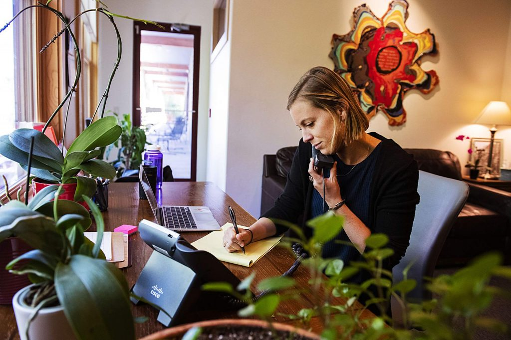 Aspen Hope Center's crisis clinician demonstrates what her work day looks like as she answers calls through the crisis hotline in the office in Basalt on Thursday, July 2, 2020. (Kelsey Brunner/The Aspen Times)