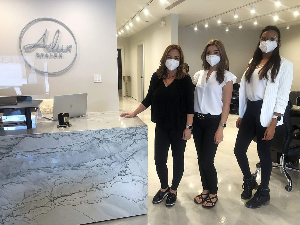 From left, Maria Sanchez, Jaqui Farias and Brenda Monrroy stand in the new Alux Spalon location in Snowmass Base Village on July 7, 2020. (Maddie Vincent/Snowmass Sun).