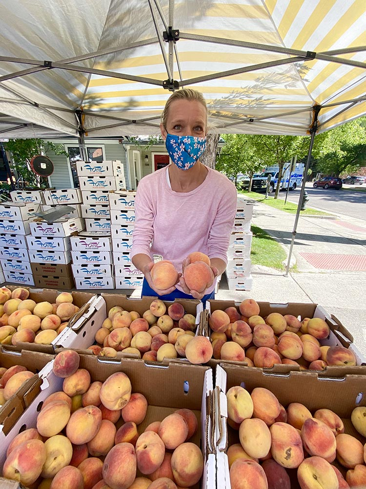 Anna Zane with peaches for days from Forté Farms in Palisade.